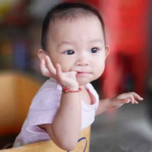 baby biting it's fingers