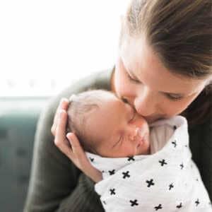 Mama cradling newborn baby
