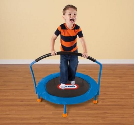 Boy on small indoor trampoline