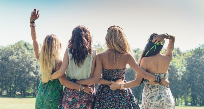 4 young women looking at the sunset after finding each other in a MILSO groups online.