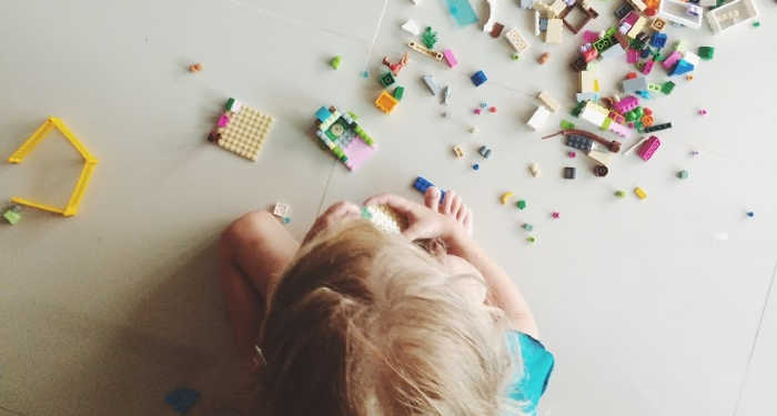 perfectionist child playing with lego