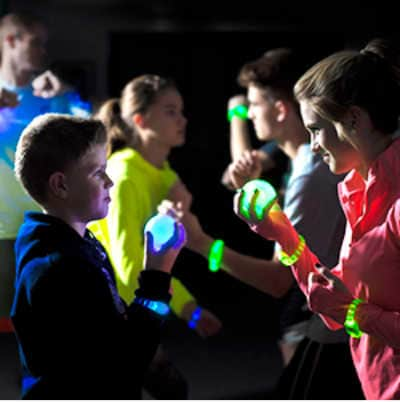 Glow in the dark capture the flag game for kids to play outside.