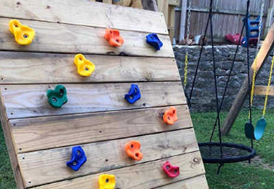 DIY outdoor rock wall for kids. Make using rock climbing holds.