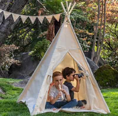 Outdoor teepee for kids to enjoy imaginative play.