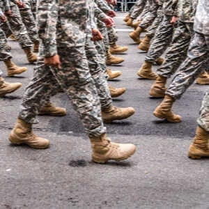 military service members marching - legs and boots