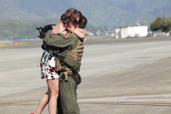 Military boyfriend and his girlfriend hugging after he returned from deployment.