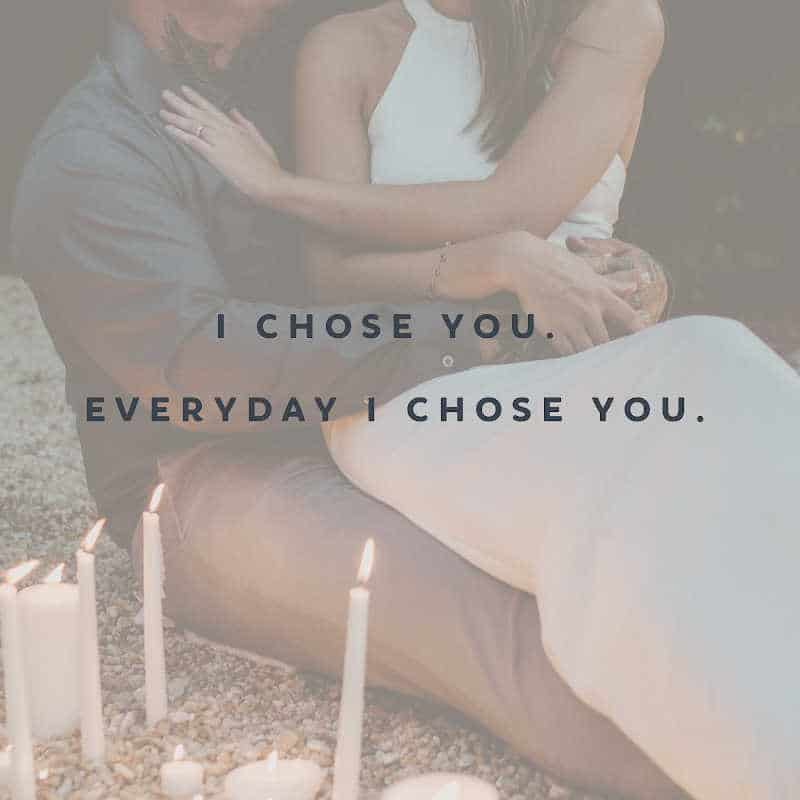 man and woman couple embracing with candles around them. Text reads: I chose you. Everyday I chose you.