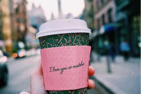 "Coffee cup with sleeve that reads ""I love you so matcha."""