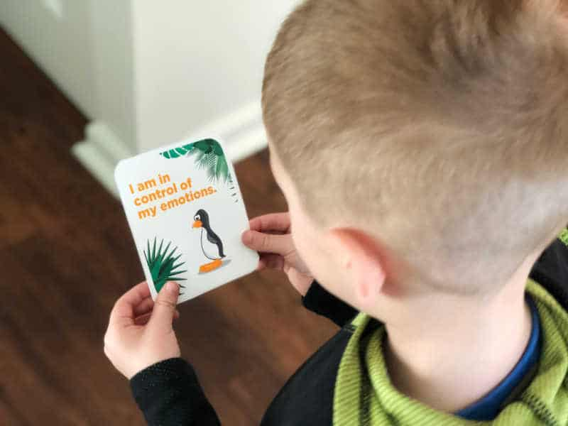 """Toddler holding affirmation card that says """"I am in control of my emotions."""""""