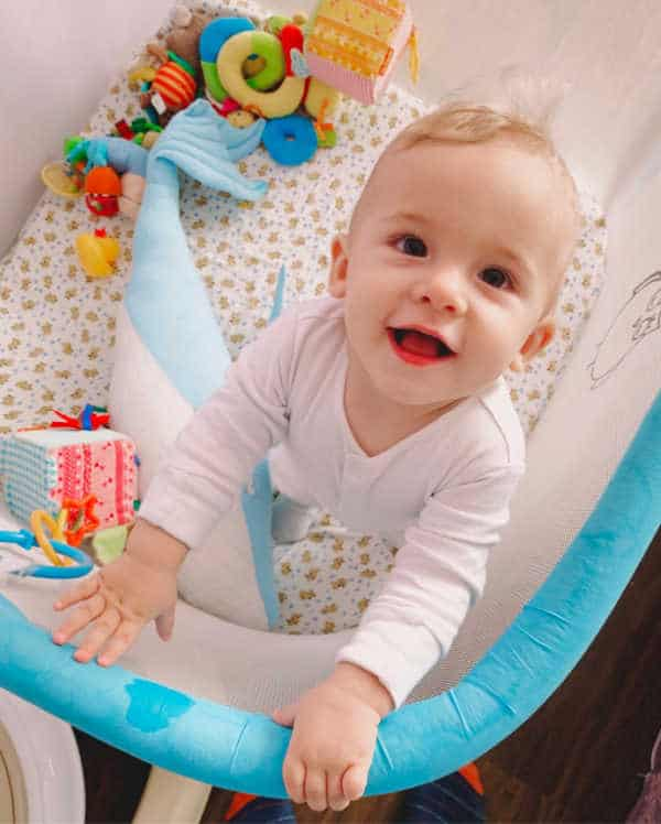 1 year old in playpen during independent playtime