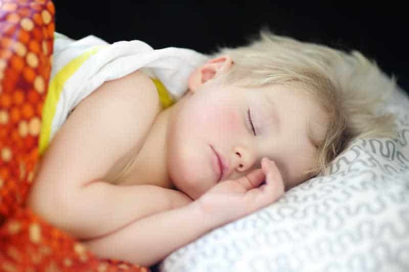 1 year old sleeping in bed
